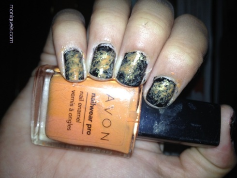 Black white and orange nail polish