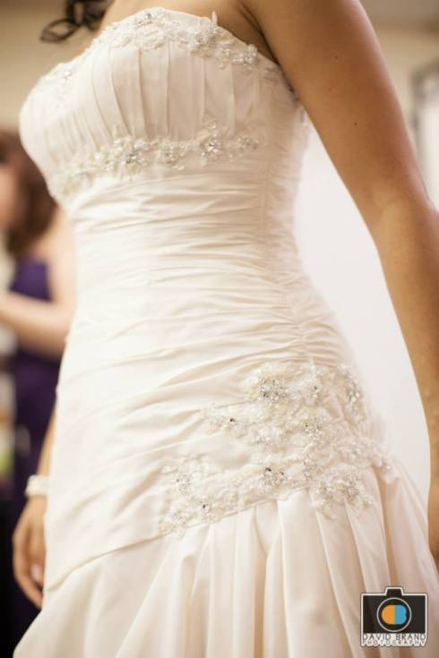 Dress detail. Absolutely love my wedding dress. It was inexpensive and gorgeous. I felt beautiful and elegant!